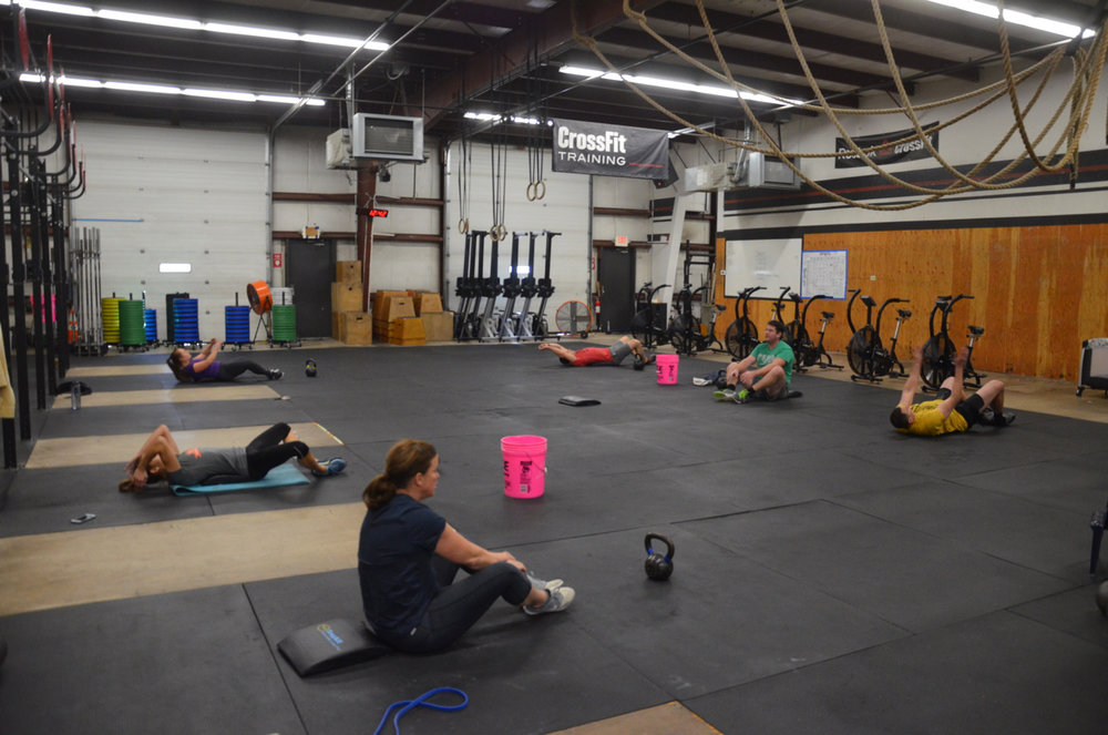The noon class during their 42 sit-ups.