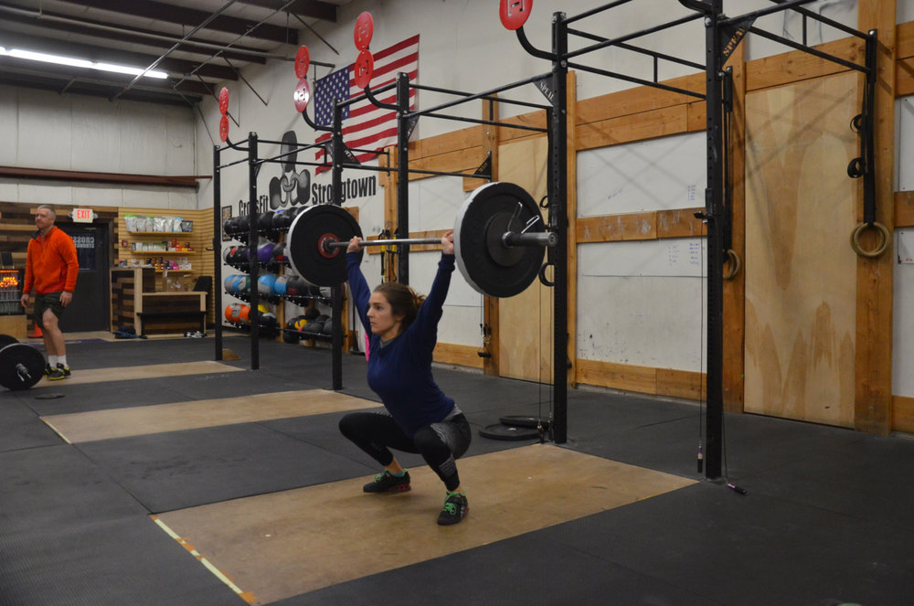 Kat showing great depth on her hang squat snatch.