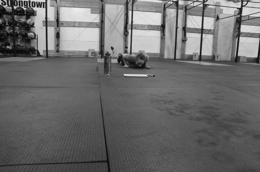 Cardella at the bottom of her burpee.