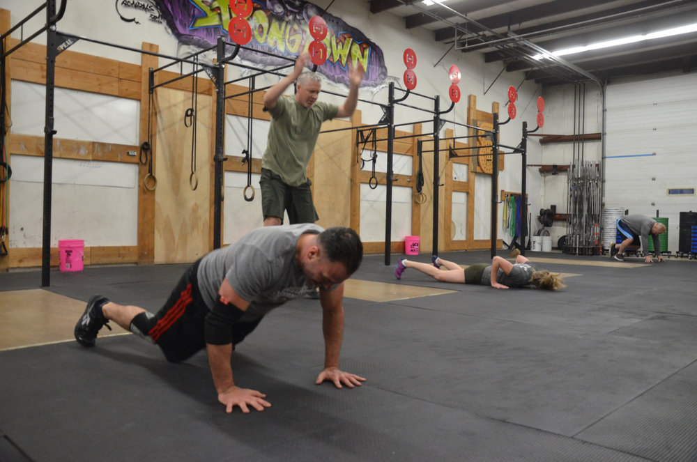 Rob, Dave, Hope & Keith at all different stages of the burpee.