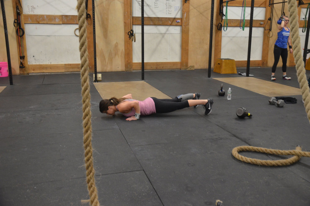 Jen making sure to go chest to deck for today's push ups.