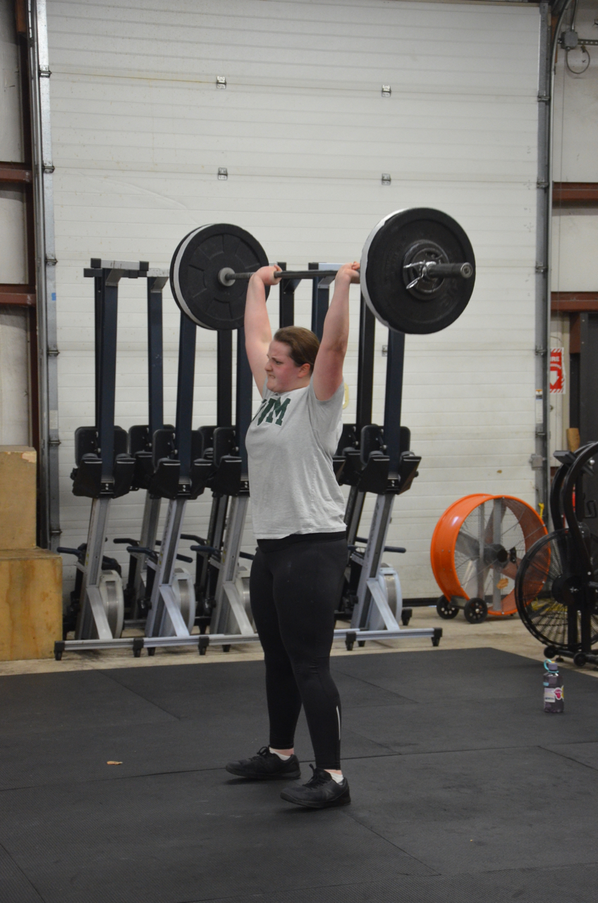 Abby fighting for the lockout on her Clean & Jerk.