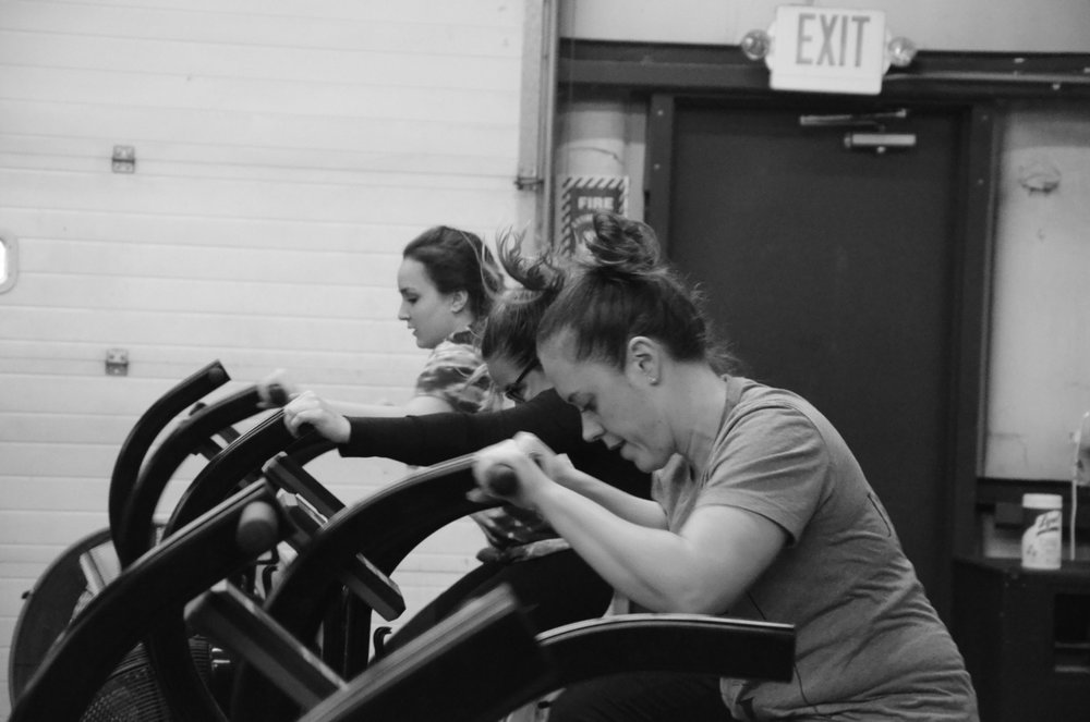 Courtney, Jordan and Aileen fighting for their 10 cals on the Xebek bike.