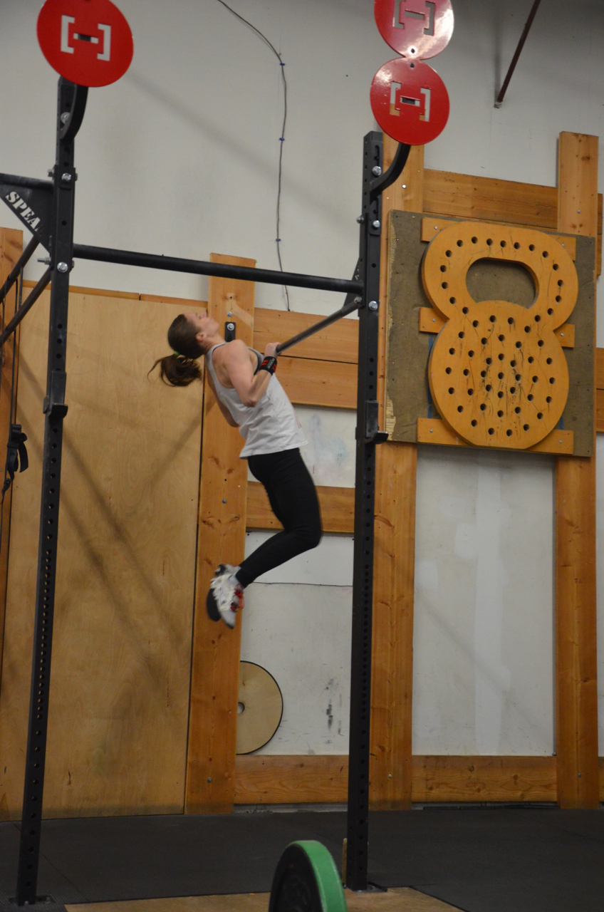 Gail making sure to make contact during her chest to bar pull-ups.