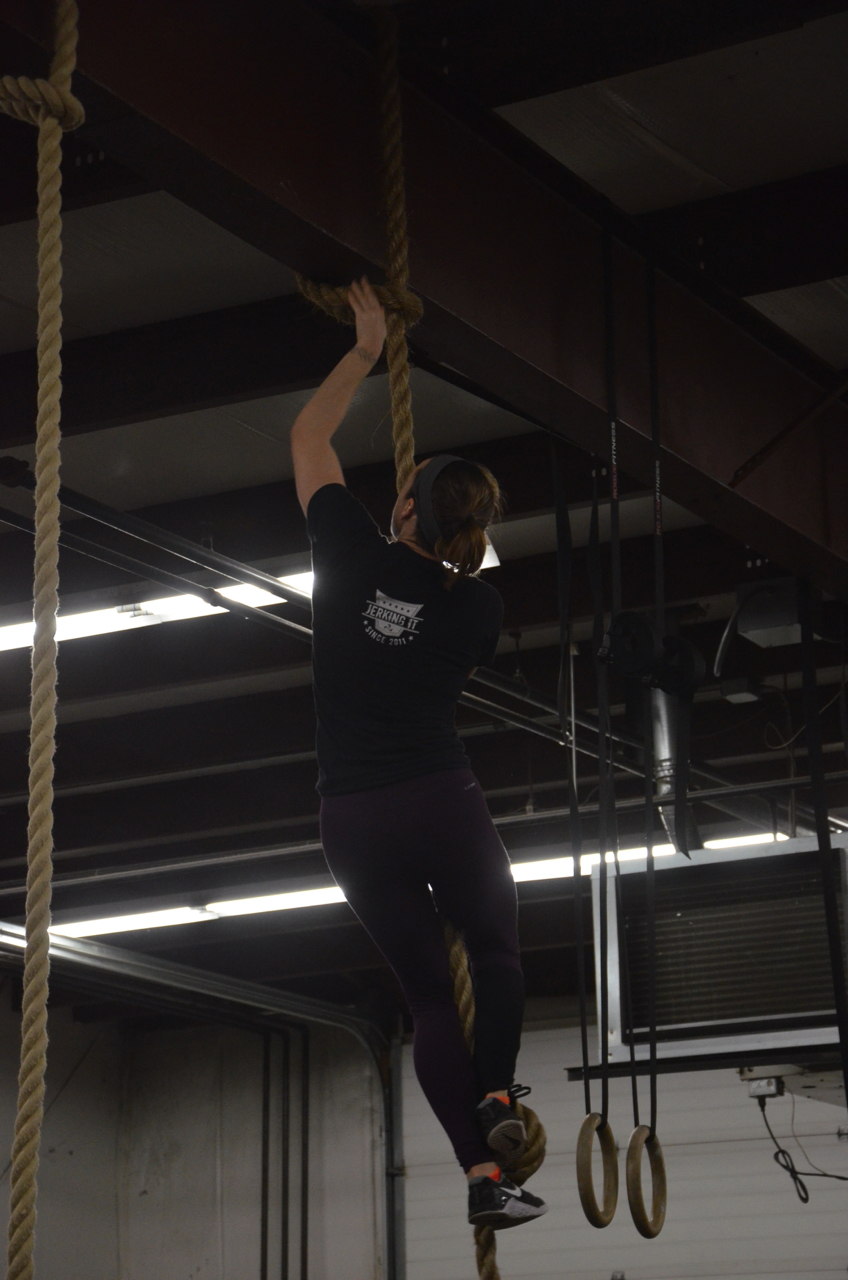 Kelly making contact with the beam at the top of her rope climbs.