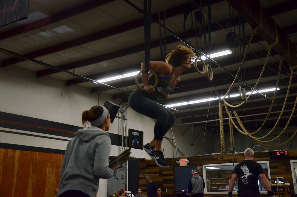 Angela pressing out of her muscle-up.