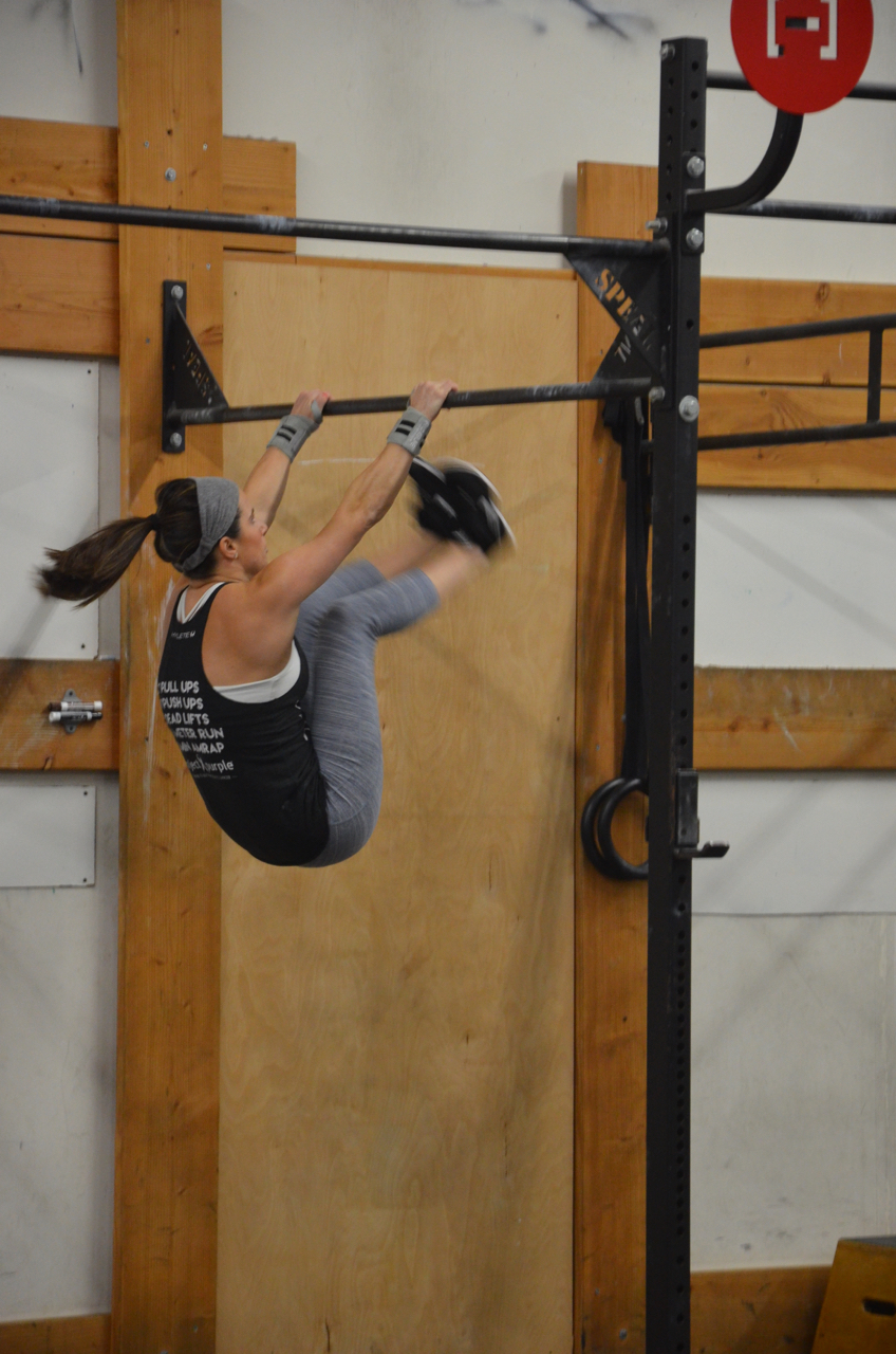 Jen showing great form on her toes to bar.