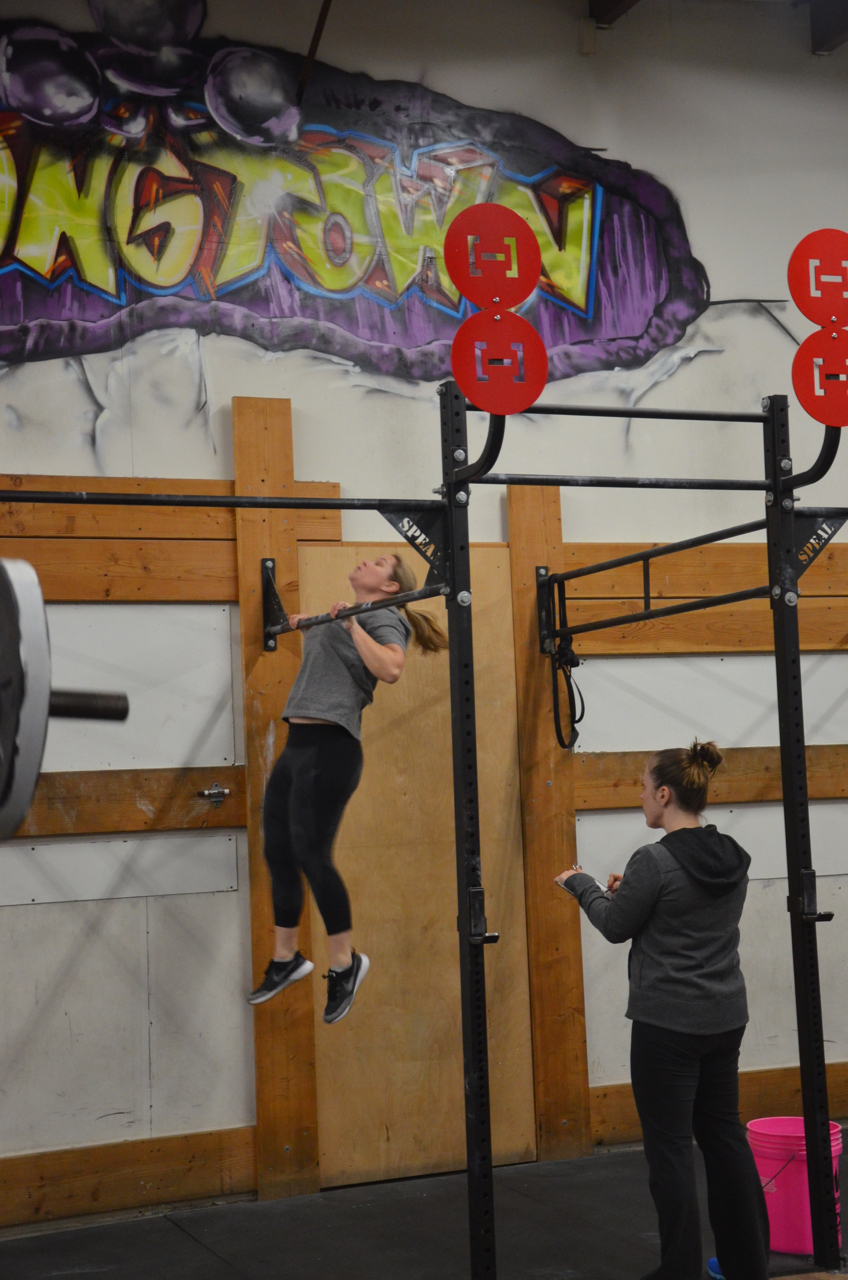 Dani making sure to make contact for her chest to bar pull-ups.