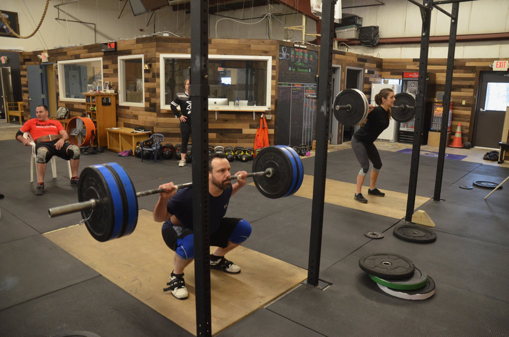 Tommy and Kat warming up their 10 rep back squats.