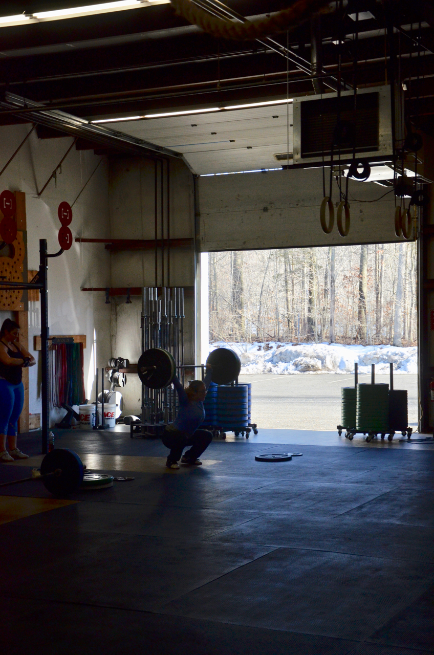 Jordan enjoying the open doors and some quality time under the barbell.