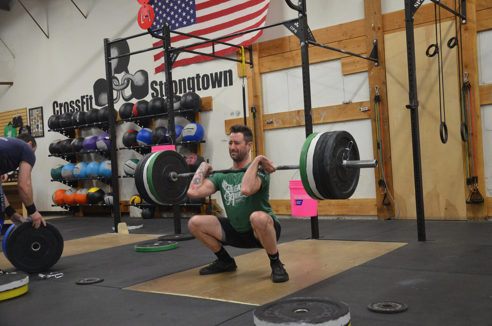Tom at the bottom of his squat clean.