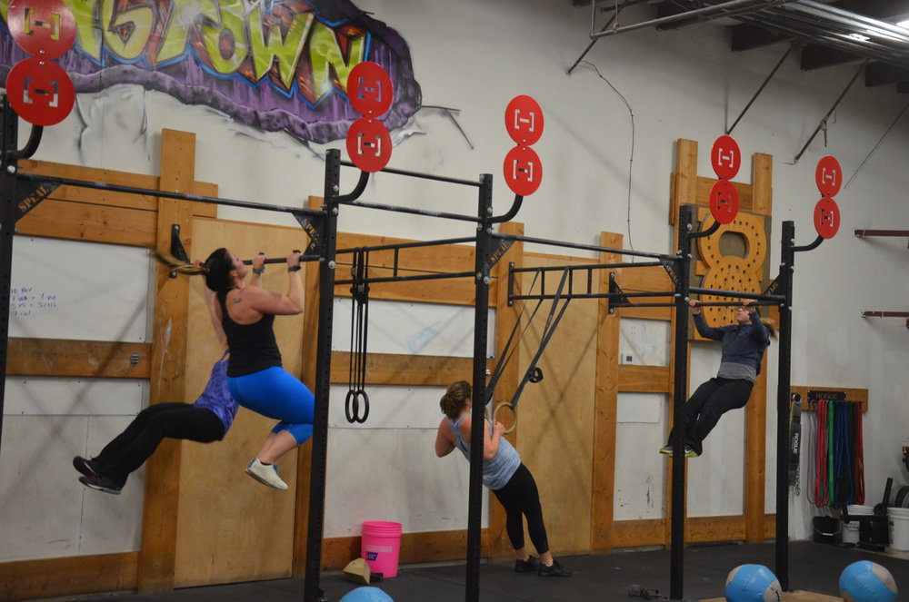Part of the 6pm class during the pull-up portion of today's WOD.
