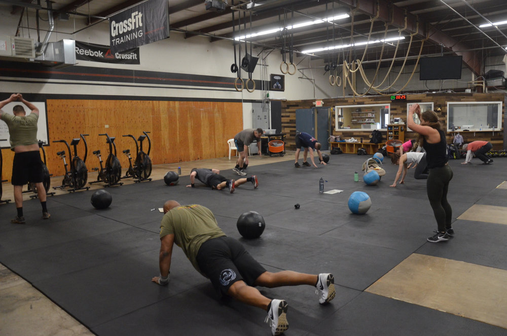 The Friday 9:30am class working through the metcon of med-ball cleans and burpees.