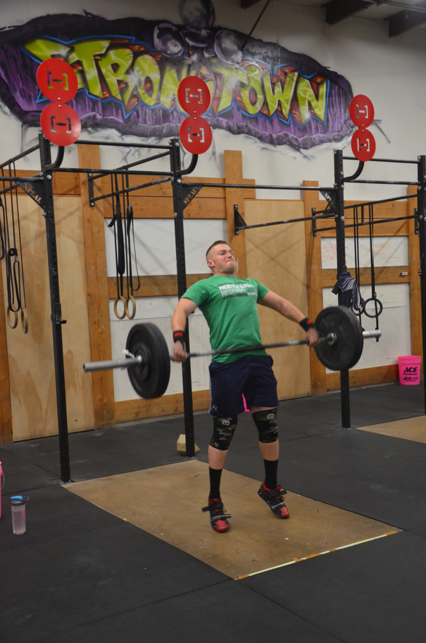 Taylor showing a great extension during the 3 position Snatch.