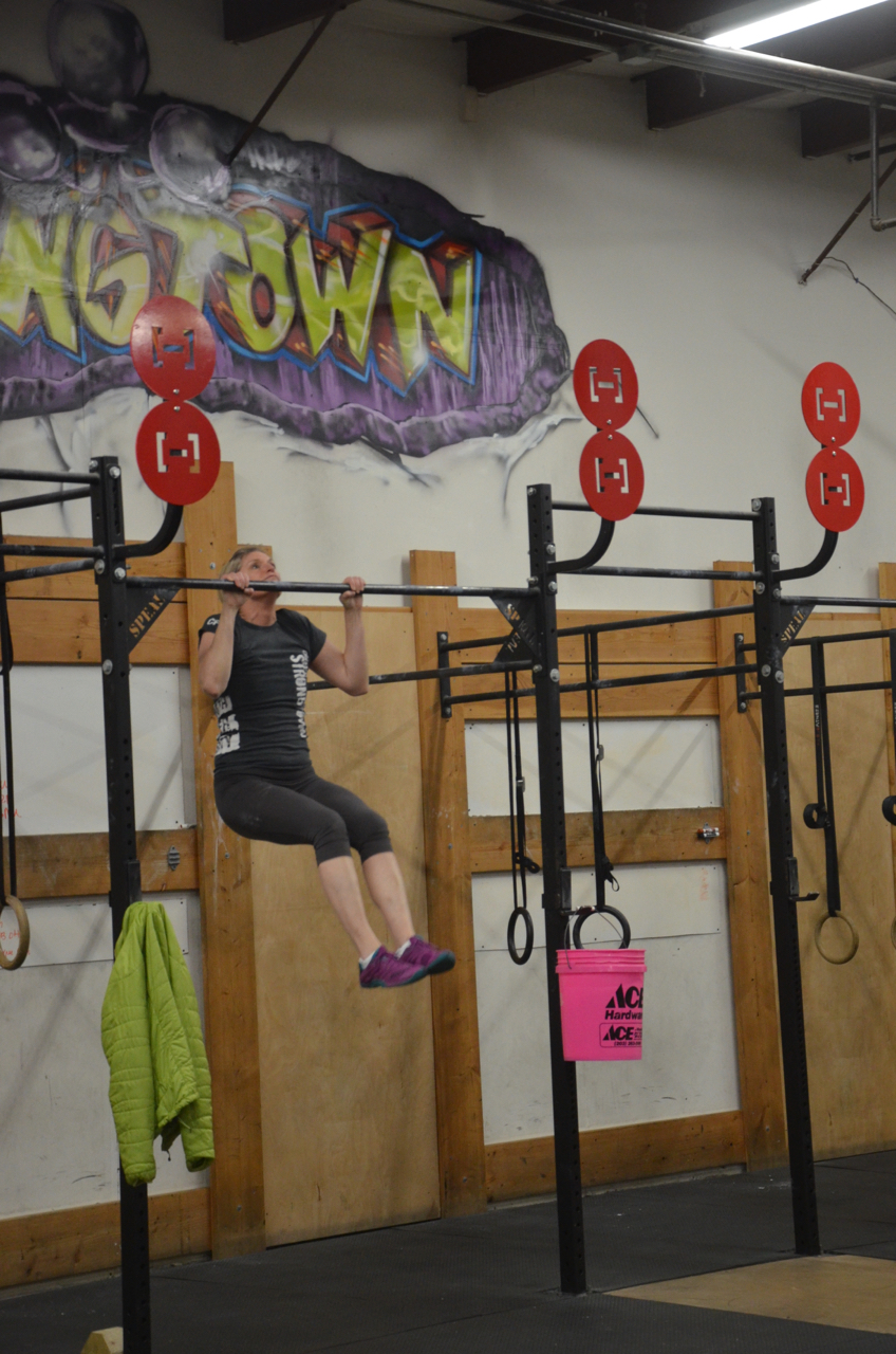 Hope making sure to get her chin over the bar during her pull-ups.