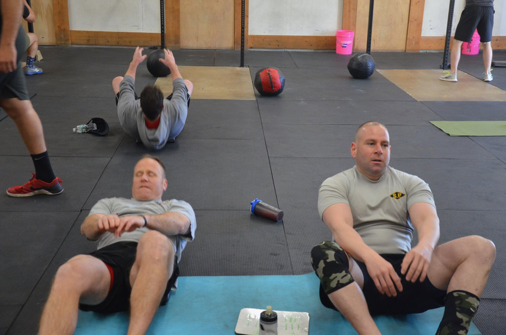 """BVN and Rob working through local hero wod """"Miller"""" in honor of their fallen brother."""