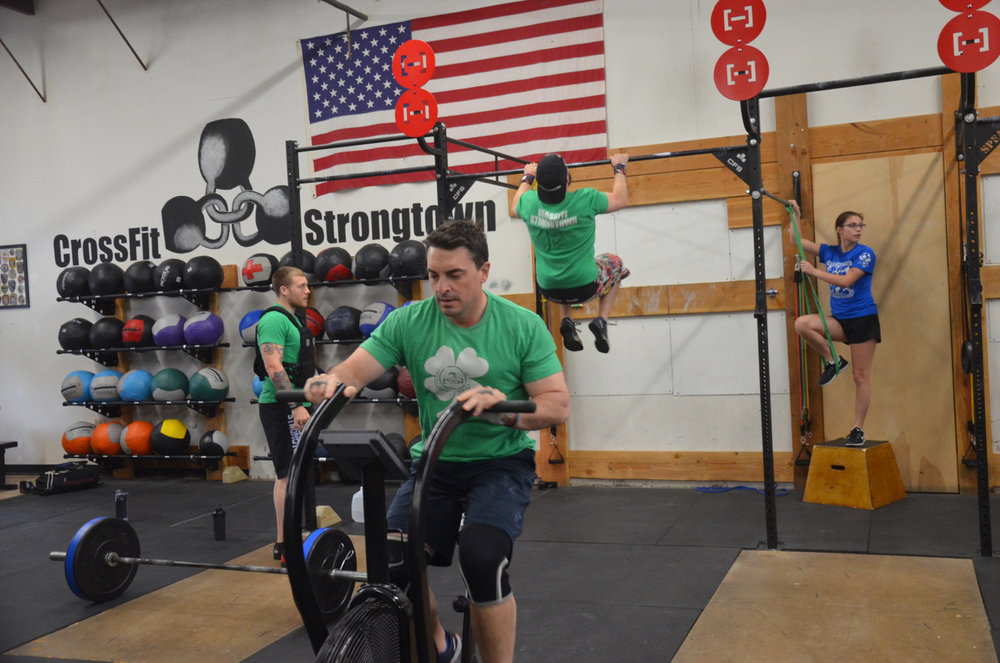 Brian, Matty and Kevin made sure to wear matching Strongtown shirts for Sunday's partner wod.