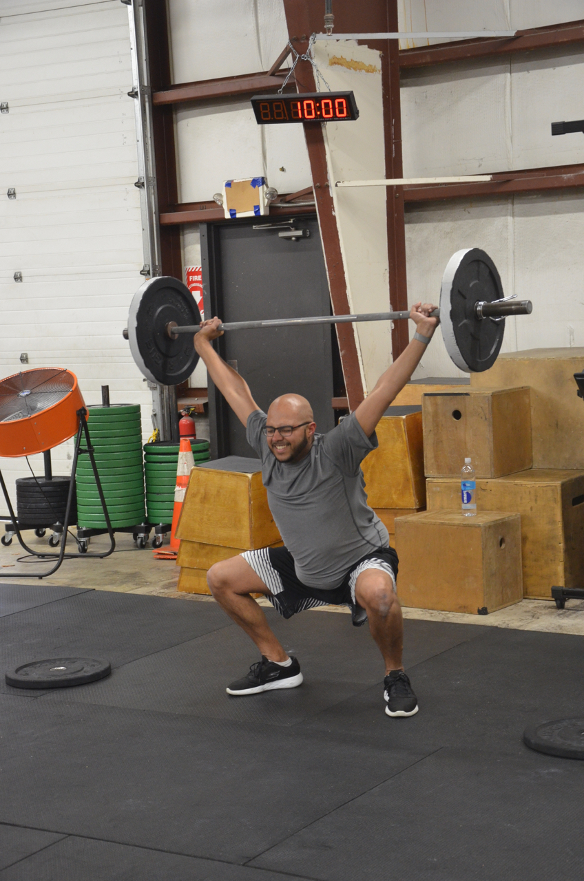 Xavier fighting to make sure he gets full depth on his overhead squat.