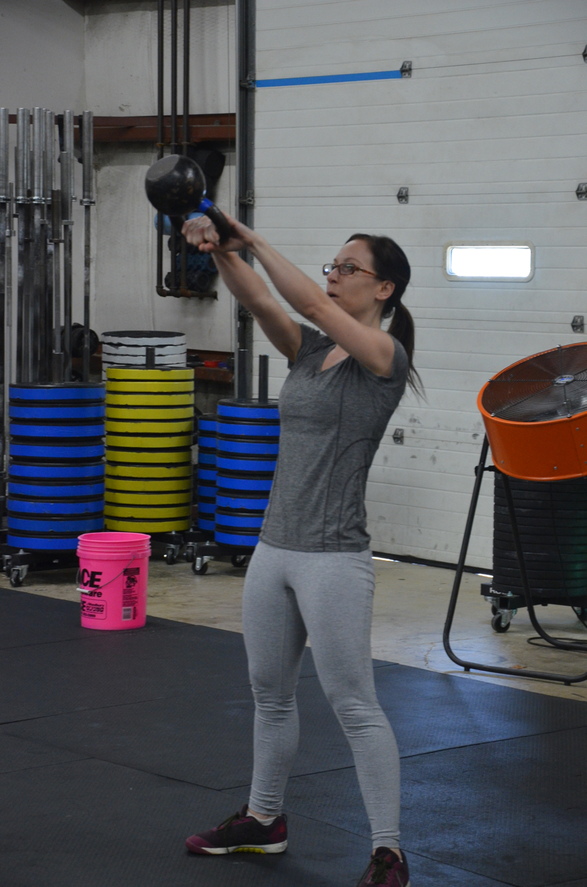 Leila making sure the Kettlebell reaches eye level during her Russian KB swings.