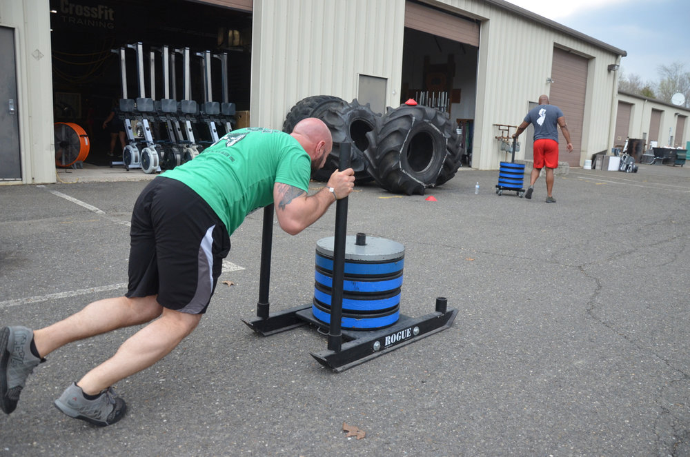 Glasser moving some good weight on his dog sled push.
