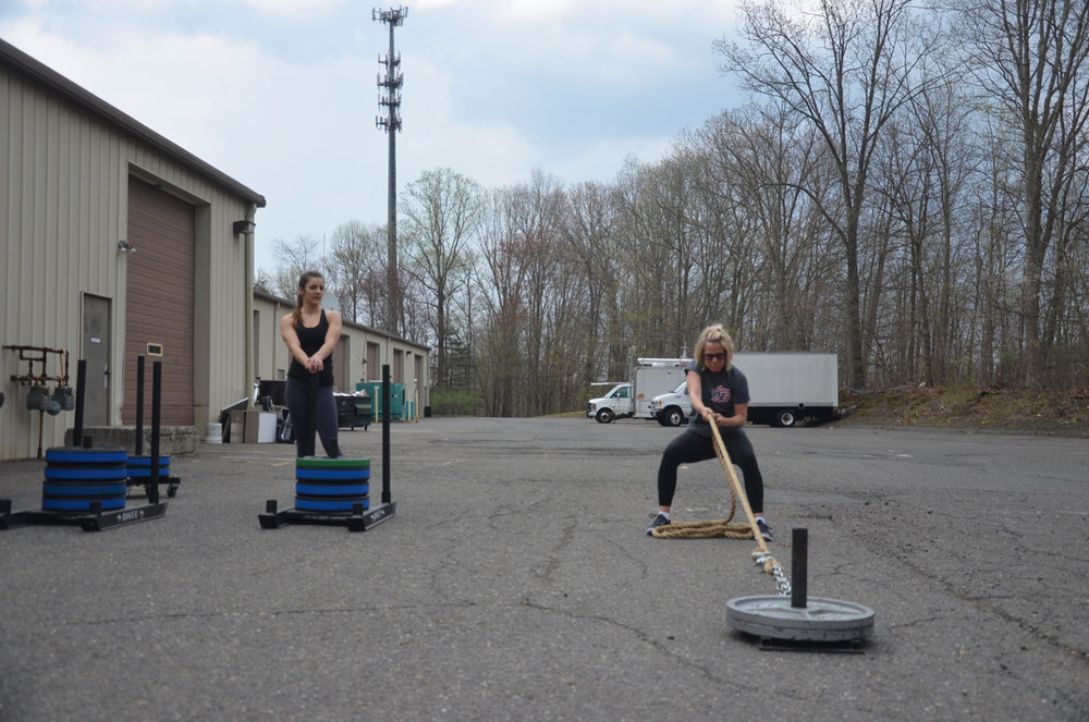 Paula making sure to keep her feet planted during her sled pull.