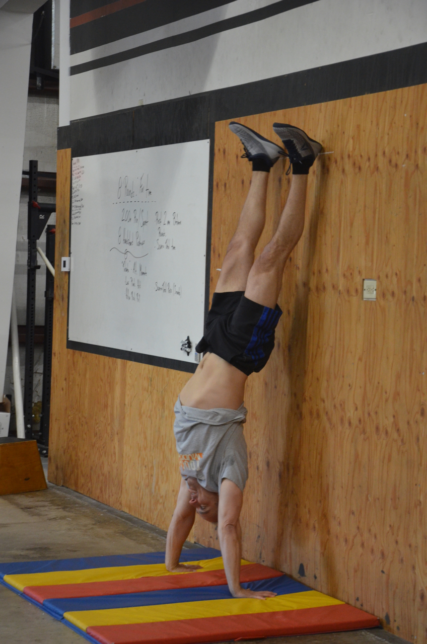 Funk showing a great lockout on his handstand push-ups.