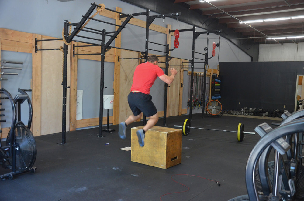 Kevan working through his burpee box jump overs in the annex.
