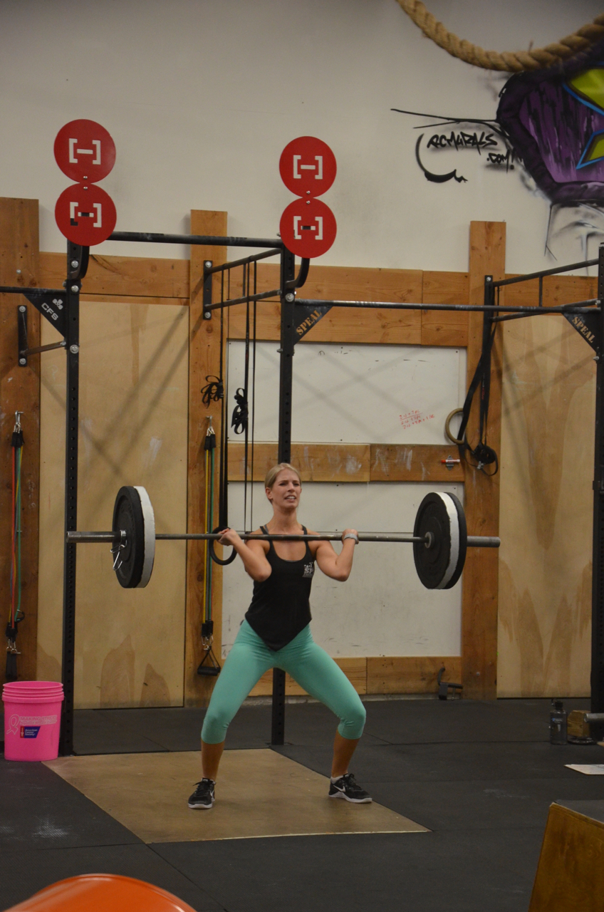 Sam showing a good catch position on her power clean.