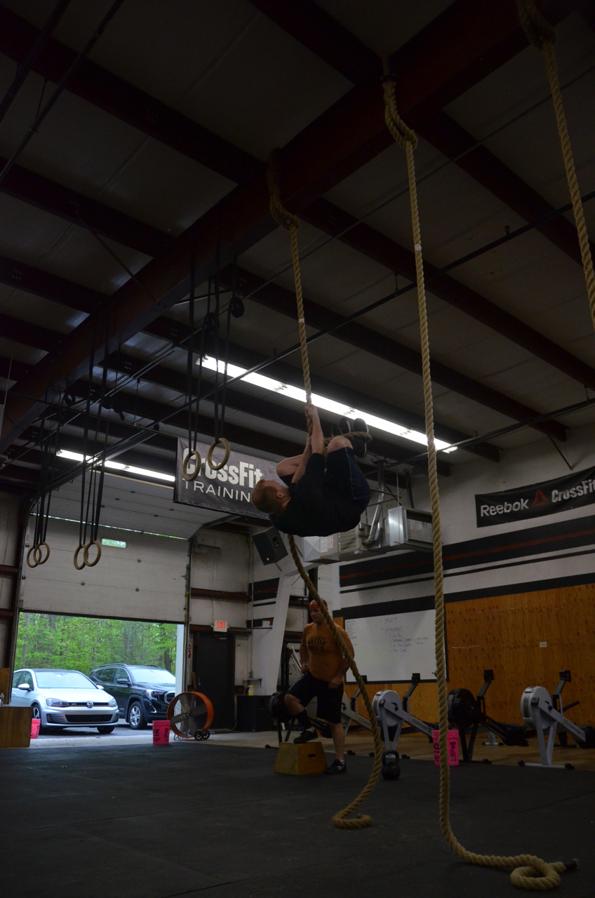Ryan making sure to get his knees up on his rope climbs.