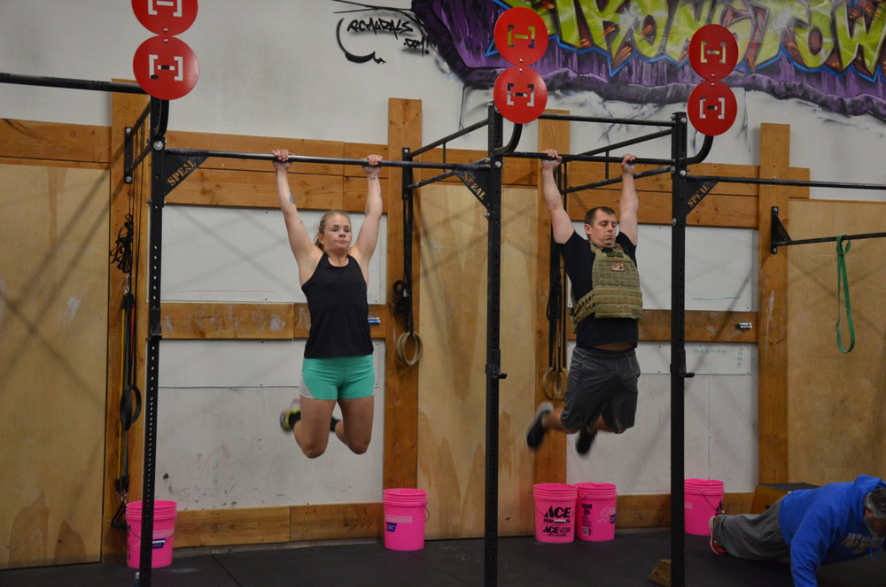 Heidi and Garrett during their pull-ups.
