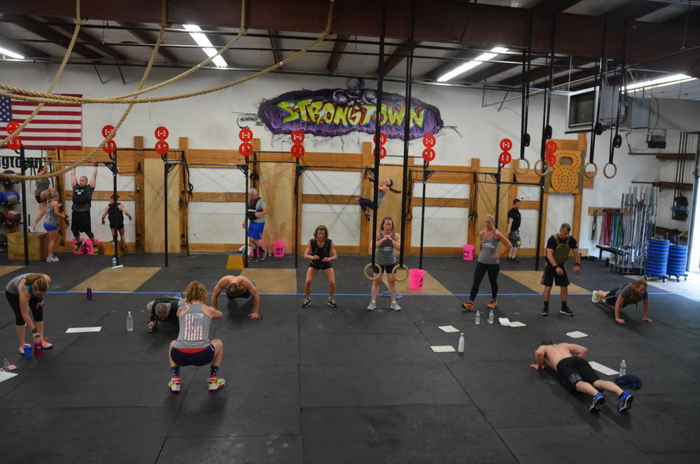 Sunday 8am class working through their 100 pull-ups, 200 push-ups, and 300 air squats.
