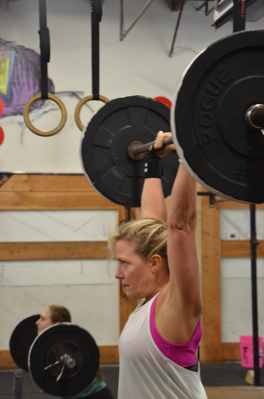 Kristie showing a great lockout overhead on her Thrusters.