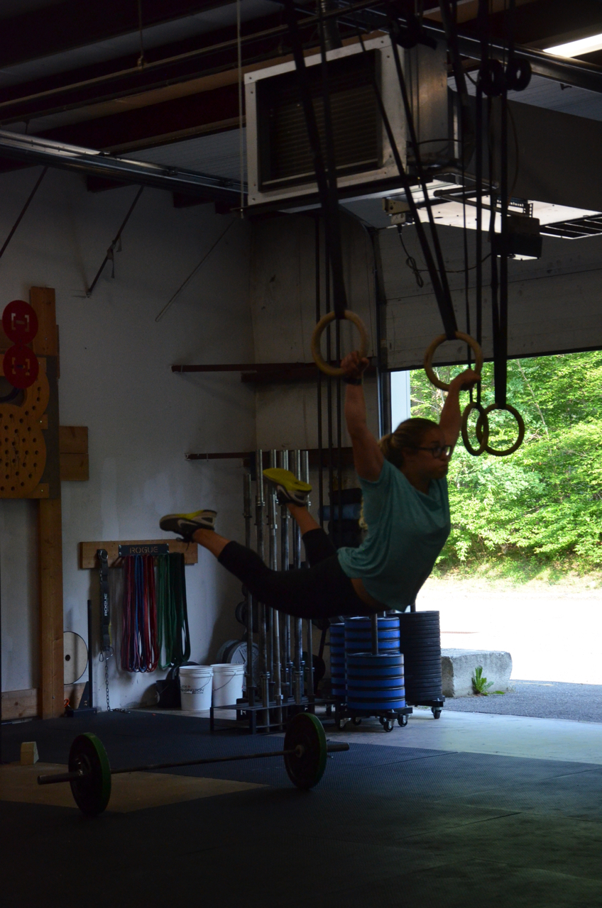 Jordan showing a nice turnout on her ring muscle-ups.