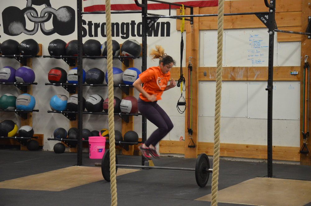 Sara during her lateral bar burpees at Saturday's 9am class.