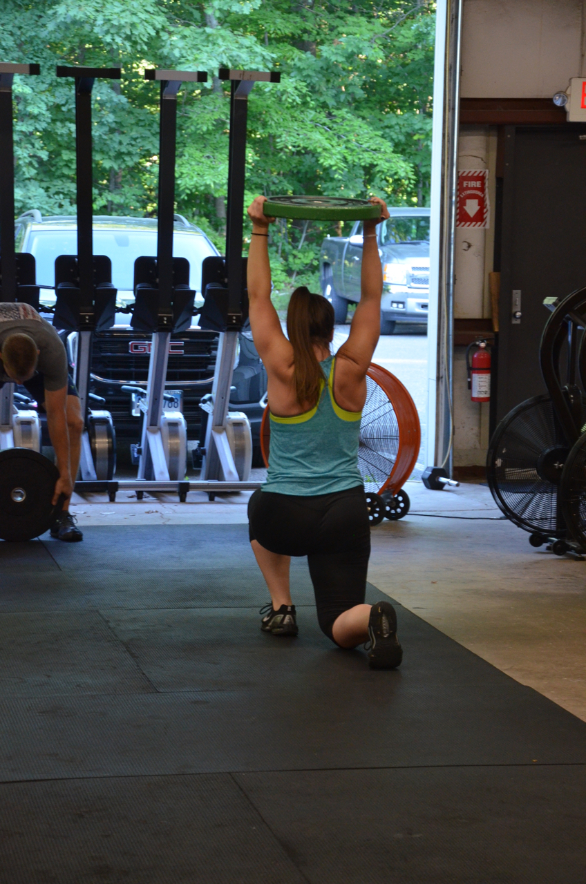 Jess looking strong through her overhead walking lunges.