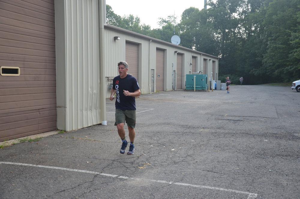 Bill finishing his last 400 meter run.
