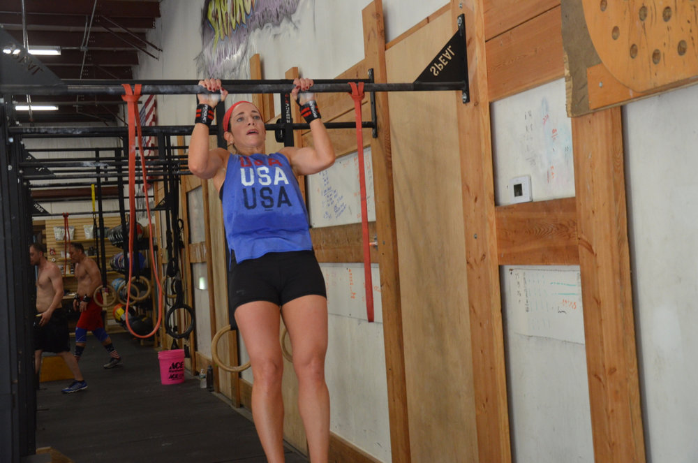 Holly keeping tight on her strict pull-ups.