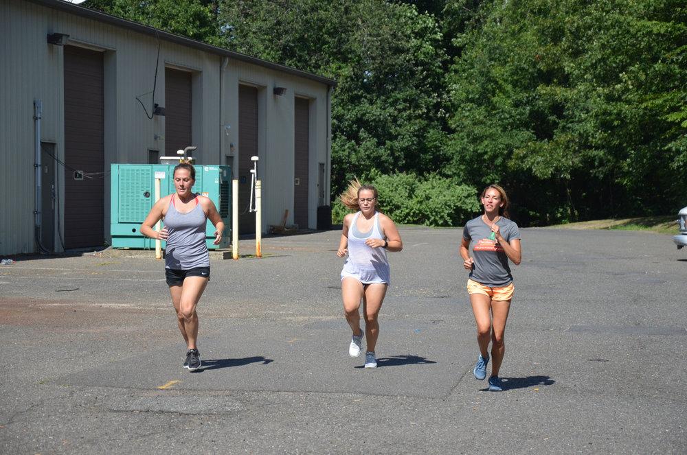 Steph, Lu and Danielle finishing their first 400 meter run.