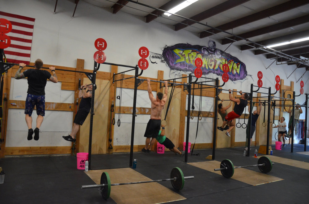 The 5pm class during their first 50 pull-ups.