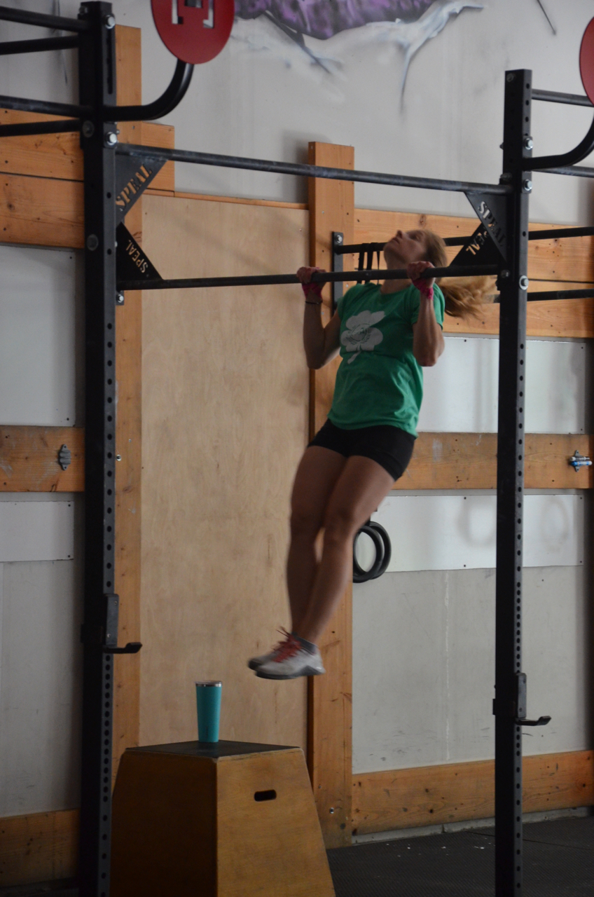 Sophia making sure to get her chin over the bar during her pull-ups.