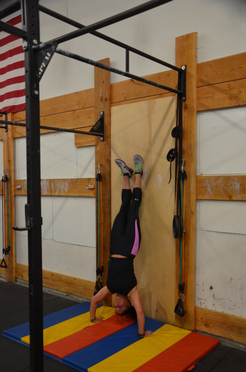 Tammy pressing out of her Handstand Push-ups.