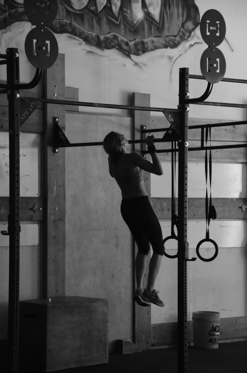 Danielle getting her chin over the bar for her Pull-ups.