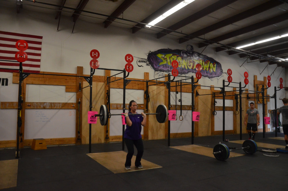 """Kristin working through the """"Pollywog"""" barbell complex."""