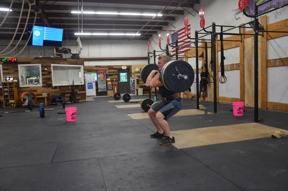 Scotty warming up to his 1 rep max Hang Power Clean.
