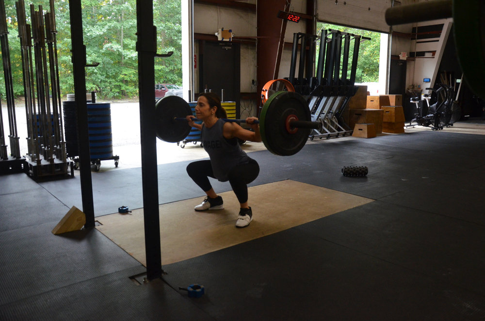 Holly at the bottom of her Pause Back Squats.