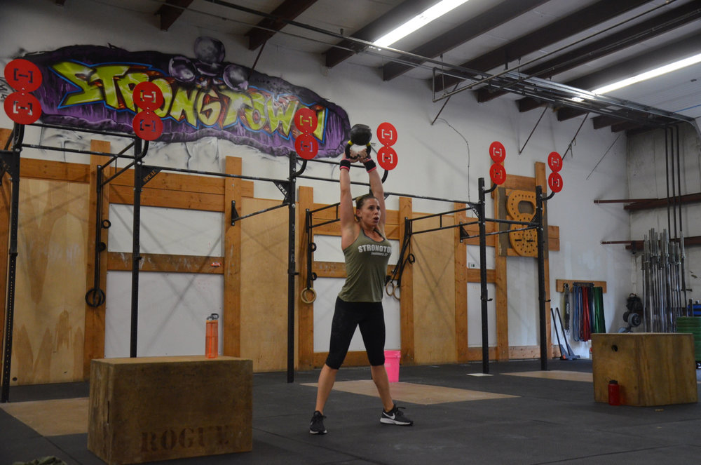 Sabrina showing a good lockout on her Kettlebell Swings.