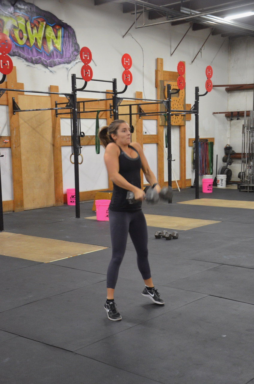 Kat showing a great pull on the Double Dumbbell Clean & Jerk.