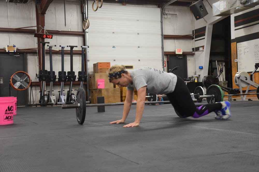 MB working through her lateral bar burpees.