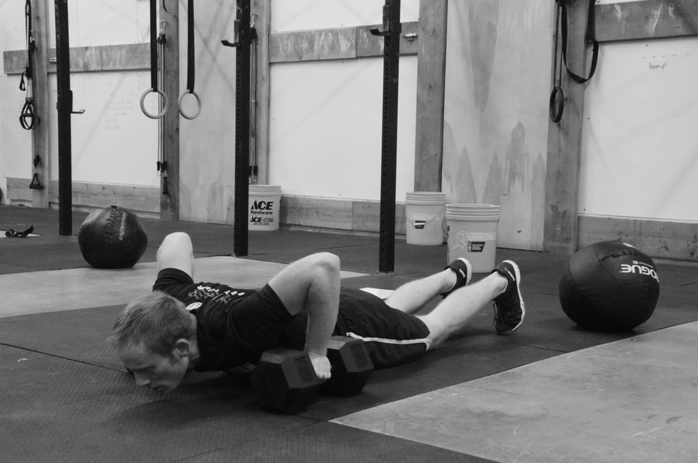Chris making sure to go chest to deck on his Dumbbell Burpee Deadlifts.