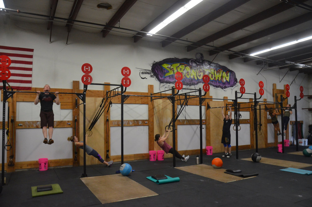 Friday's 4pm class working through their strict pull-ups.